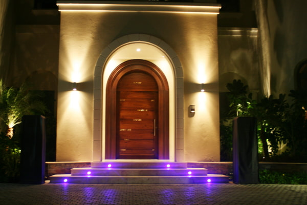 Create visual depth by layering exterior wall lighting available from Eco Industrial Supplies